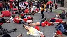 Demonstrators protest the Harper government's proposed prostitution legislation on a Toronto street Saturday, June 14, 2014. (William Campbell/THE CANADIAN PRESS)
