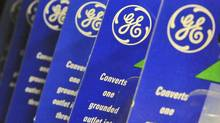 A General Electric Co. logo appears on outlet converter packaging in this file photo. (Lisa Poole/AP)