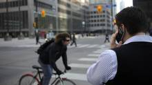 A man talks on his cellphone in Toronto. (Fred Lum/Fred Lum/The Globe and Mail)