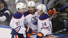 Edmonton Oilers' Ryan Nugent-Hopkins (L) and Taylor Hall (C) celebrate Jordan Eberle's (R) goal during the first period of their NHL game against the St. Louis Blues in St. Louis, Missouri March 26, 2013. (SARAH CONARD/REUTERS)