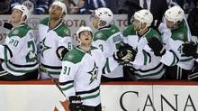 Dallas Stars forward Tyler Seguin (91) looks up at the replay of his goal as he celebrates with his teammates during the second period against the Winnipeg Jets at MTS Centre. (Fred Greenslade/USA Today Sports)