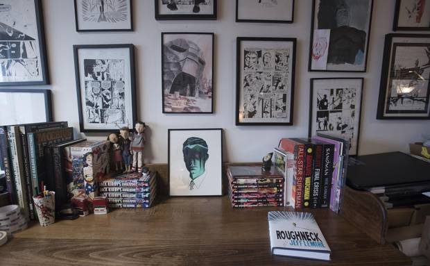 The walls of Jeff Lemire's Toronto studio are covered with artwork from other graphic novelists.