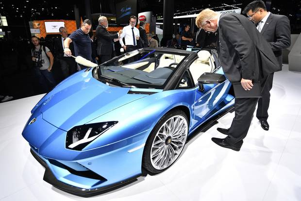 Visitors look at a Lamborghini Aventador S Roadster on the first media day of the International Frankfurt Motor Show IAA in Frankfurt, Germany, Tuesday, Sept. 12, 2017, which runs through Sept. 24, 2017.