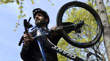 Sacred Rides Mountain Bike Adventures founder and president Mike Brcic, with his mountain bike (Fred Lum/FRED LUM/THE GLOBE AND MAIL)
