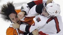 Philadelphia Flyers center Danny Briere (48) and Ottawa Senators center Kyle Turris (7) trade blows while fighting during the second period of their NHL ice hockey game in Philadelphia, Pennsylvania, January 7, 2012. REUTERS/Tim Shaffer (TIM SHAFFER)