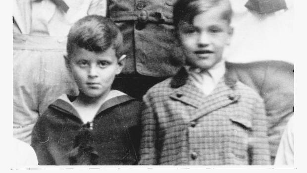 Peter Munk, left, was born into a wealthy Jewish family in Budapest in 1927. His family later escaped Nazi persecution by fleeing to Switzerland on the Kastner train, which carried roughly 1,700 Jews to safety in 1944. (From the book Kasztner's Train)