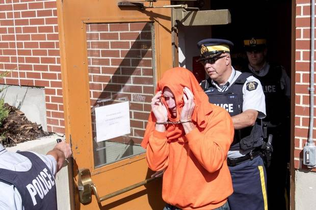 Gerald Stanley leaves in custody after his bail hearing in North Battleford, Sask. on Aug. 18, 2016.