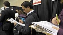 Applicants line up at the National Job Fair and Training Expo in Toronto on April 5, 2012. (J.P. MOCZULSKI/J.P. Moczulski for The Globe and Mail)