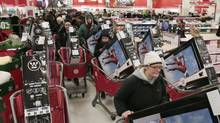 Shoppers take advantage of Black Friday sales in the early morning at a Target store Friday, Nov. 26, 2010, in Chicago. The store opened at 4 a.m. on Friday. (Kiichiro Sato/(AP Photo/Kiichiro Sato))