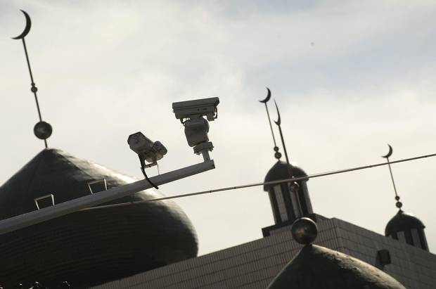 Security cameras are seen on a street in Urumqi, capital of China's Xinjiang region on July 2, 2010.