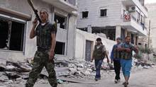 Members of the Free Syrian Army patrol the streets of Aleppo on Wednesday. (Zain Karam/REUTERS)