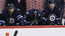 Winnipeg Jets' James Wright (17), Evander Kane (9) and Eric Tangradi (27)Êshows their disappointment of losing to Montreal Canadiens during third period NHL action in Winnipeg on Thursday, April 25, 2013. (JOHN WOODS/THE CANADIAN PRESS)