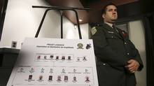 A board listing accused drug traffickers and dealers is seen during a news conference by the Surete du Quebec (SQ) police force about 'Operation Loquace', a major drug bust in three provinces, in Montreal November 1, 2012. (REUTERS/Christinne Muschi)