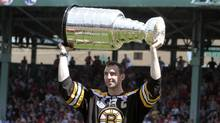 Boston Bruins Zdeno Chara holds up the Stanley Cup during a tribute to the Bruins before an interleague baseball game between the Boston Red Sox and the Milwaukee Brewers in Boston, Sunday, June 19, 2011. (AP Photo/Michael Dwyer) (Michael Dwyer)