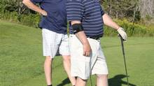 Tim Murphy, left, chair of the organizing committee for the Calvert Masters Golf Tournament, and Loyola Sullivan participate in the annual fundraiser.