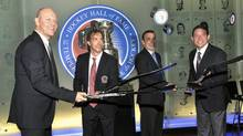 Hockey Hall of Fame 2012 inductees (L-R) Mats Sundin, Joe Sakic, Adam Oates and Pavel Bure flip pucks off hockey sticks during a news conference in Toronto November 12, 2012. (MIKE CASSESE/REUTERS)