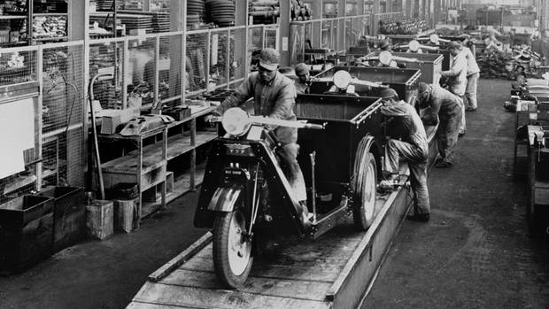 The assembly line in Hiroshima, Japan, where the first Mazda vehicles were built in 1937. (Roger-Viollet)