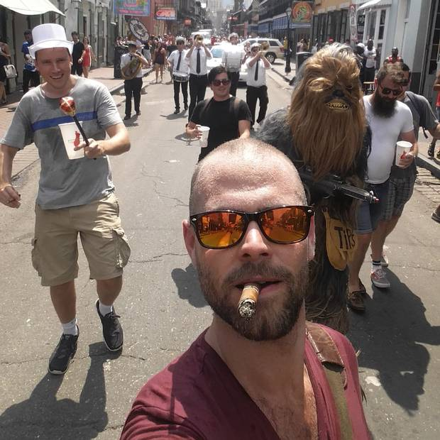 Chris, the groom in a top hat, leads the parade with his trusty sidekick, Chewbacca.