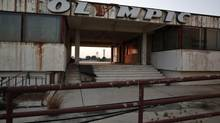 The Olympic Airways logo is seen on a building at the former Athens International airport, Hellenikon. The airport has been abandoned for 13 years. Now the Lamda group hopes to turn it into a prime seaside resort. (YORGOS KARAHALIS/Reuters)