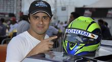 "Former Ferrari Formula One driver Felipe Massa of Brazil had the nickname ""Schumi"" on his helmet as a tribute to Michael Schumacher, while competing in a karting race International Challenge of the Stars on January 11, 2014. Schumacher, a seven-times Formula One champion who retired in 2012, is in a critical condition with brain injuries. The German has been in an induced coma since then and has undergone two operations in Grenoble since December 29, 2013. (REUTERS)"