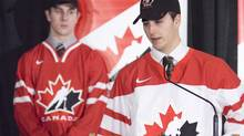 WHL Regina Pats centre Jordan Eberle (right) speaks at a press conference as teammate Colten Teubert looks on at an announcement of the thirty-six players invited to the Canada National Junior team selection camp in Regina, Sask. on Wednesday, Dec. 2, 2009. Eberle and Teubert were both on last year's gold medal winning team and are two of seven players invited back from that team. THE CANADIAN PRESS/Troy Fleece (TROY FLEECE)