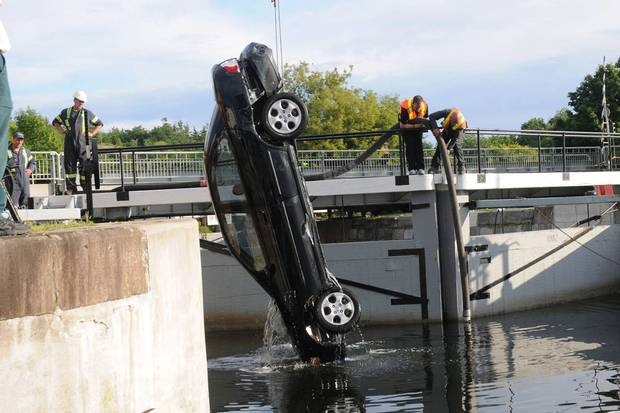 A court-released photo from the Shafia trial shows authorities hauling a car from Kingston's Rideau Canal locks on June 30, 2009. Three sisters and their stepmother were drowned in the car; the girls' father, his wife and their son were found guilty of murder. The complex Shafia case put a strain on Kingston's court system that, along with bureaucratic errors, delayed the sex-assault case against Kenneth Gavin Williamson.