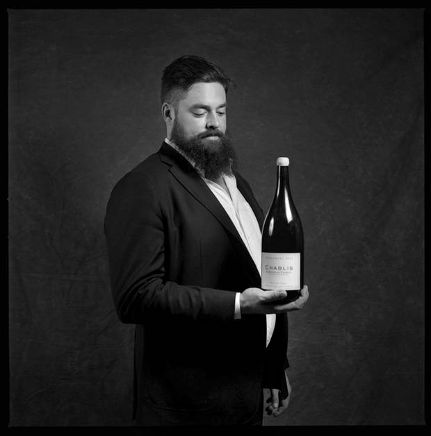 Chris Wickens, is photographed at the Toronto restaurant La Banane with 2015 Chardonnay, Patrick Piuze Chablis, France.