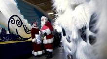 Mr. and Mrs. Santa Claus chat in the wings while waiting to be introduced. The media were invited to the Toronto warehouse on Nov. 2, 2012 where the floats for the 108th Santa Claus Parade are being prepared for Nov. 18th, 2012. (Peter Power/The Globe and Mail)