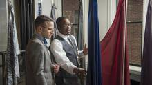 Customer Evan Gildenblatt, left, looks over materials for suit linings with stylist Jabari Stewart at Indochino's pop-up store in Washington, one of several sites across North America in which the Victoria-based online retailer has offered its products and services on a temporary basis. (Thomas Graves For the Globe and Mail)