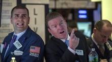 Traders work on the floor of the New York Stock Exchange March 14, 2014. (BRENDAN MCDERMID/REUTERS)