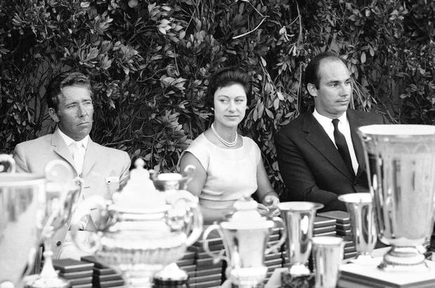 From left, Princess Margaret of Britain, Lord Snowdon and Prince Karim Aga Khan watch a yachting regatta on the Emerald Coast of Sardinia, Italy on Aug. 14, 1966.