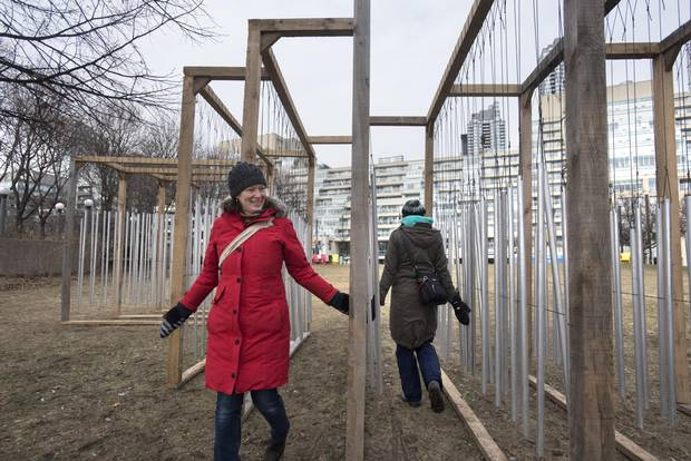 Laura Bunston (RED) and her sister Marcia, explore an art installation set up at the Music Garden on Jan 25 2018. 'Ensemble' by Joo Arajo Sousa and Joana Correia Silva, JJs Arquitectura (Porto, Portugal). Ensemble merges architecture, music and astronomy to explore the dialogue between humans and the urban environment. The installation is inspired by wind chimes, which visitors can touch to create beautiful abstract compositions and ever-changing soundscapes.