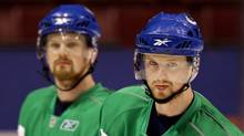 Vancouver Canucks forwards Henrik Sedin, right, and his twin brother, Daniel are two of the most attractive free agents available. (DARRYL DYCK)