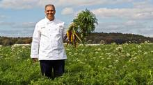 Abdel Belkadi, ARAMARK executive chef at the University of Toronto, holds different varieties of heirloom root vegetables at Carron Farms at Bradford, Ont. Carron Farms gets its name from their two primary crops – carrots and onions for which the Holland Marsh area is famous. (ARAMARK)