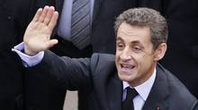 France's President Nicolas Sarkozy waves to supporters during a visit to Bordeaux on Tuesday. (Regis Duvignau/Reuters)