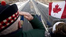 A Canadian soldier salutes in Port Hope, Ont., on Monday, Dec. 8, 2008, to pay respects to a procession for soldiers killed in Afghanistan. (CLIFFORD SKARSTEDT/THE CANADIAN PRESS)