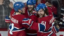 Montreal Canadiens' Max Pacioretty, centre, celebrates his goal against the Boston Bruins with teammates Brendan Gallagher, left, and David Desharnais during second period NHL playoff action on Monday, May 12, 2014 in Montreal. Desharnais and Gallagher are two of Habs diminutive forwards that are proving lack of size doesn't hamper success in today's NHL. (Paul Chiasson/THE CANADIAN PRESS)