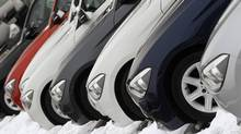 Cars for sale stand in a sales lot at a dealer in Vienna Jan. 16, 2013. Demand for new cars in Europe has fallen to the lowest level recorded since 1995, even as auto makers and dealers offered record discounts. (HEINZ-PETER BADER/REUTERS)