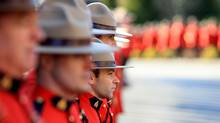 Mounties stand at attention waiting for the casket of RCMP civilian pilot Dave Brolin on January 26th, 2012. (Simon Hayter for The Globe and Mail/Simon Hayter for The Globe and Mail)