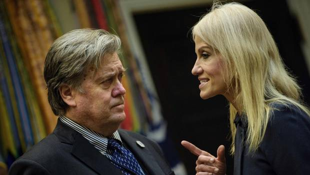 Trump aide Kellyanne Conway, right, talks to presidential counsellor Steven Bannon before a meeting on cybersecurity at the White House on Jan. 31, 2017.