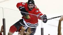 Chicago Blackhawks right wing Dustin Byfuglien celebrates after scoring goal against the San Jose Sharks during third period hockey action in Game 4 of the NHL Western Conference final Sunday, May 23, 2010 in Chicago. (AP Photo/Charles Rex Arbogast) (Charles Rex Arbogast)