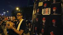 Protesters applaud beside portraits of students as a gesture against the launch of a national education programme during a mass demonstration outside government headquarters in Hong Kong September 8, 2012. The Hong Kong government said on Saturday schools did not have to adopt a China-backed curriculum from 2015 in an apparent backdown following protests by tens of thousands of people who described it as an attempt to brainwash students. (BOBBY YIP/REUTERS)