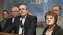 Union Leaders Michel Arsenault, FTQ, flanked by Rejean Parent, left, CSQ, and Claudette Carbonneau, CSN, stand with other union leaders in a coalition called Alliance Sociale Friday, November 5, 2010 in Quebec City. The alliance claims to be a response to the Reseau Liberte Quebec. (Jacques Boissinot/The Canadian Press/Jacques Boissinot/The Canadian Press)