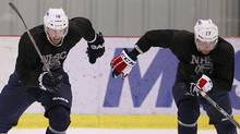 Winnipeg Jets Andrew Ladd (left) and Eric Fehr skate during an informal practice in Winnipeg on Wednesday, September 19, 2012 during the NHL player lockout. (The Canadian Press)
