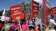 Teachers and education workers leave Queens Park after attending a rally outside the provincial legislature on August 28 2012 to protest against a controversial bill that would impose wage freezes on Ontario teachers. (Fred Lum/Fred Lum/The Globe and Mail)