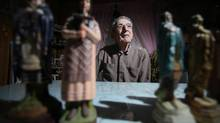 Albert Lazare, with Kateri Takakwitha statuettes in his home, is travelling to Rome. (Christinne Muschi)