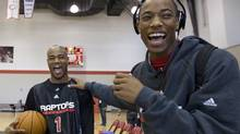 Jarrett Jack, left, and DeMar DeRozan share a laugh following practice at Toronto Raptors training camp in Ottawa on Wednesday. (Sean Kilpatrick/Sean Kilpatrick/CP)