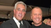 Lawrence Stroll, left, and Michael Kors during Olympus Fashion Week in 2006