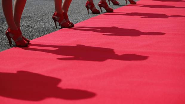Grid girls cast their shadows before the British Grand Prix at the Silverstone Race circuit, central England, June 30, 2013. (DARREN STAPLES/REUTERS)