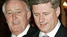 Prime Minister Stephen Harper and Brian Mulroney arrive at an Ottawa celebration of the former prime minister's time in office on April 20, 2006. (JONATHAN HAYWARD/The Canadian Press)
